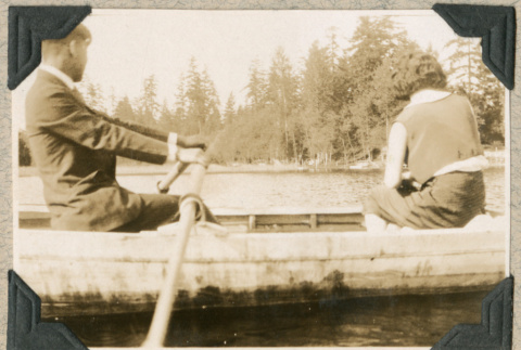 Man and woman in rowboat (ddr-densho-383-207)