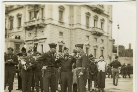 Soldiers talking with civilians looking on (ddr-densho-201-127)
