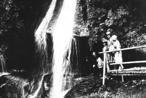 Group standing by a waterfall (ddr-densho-18-75)