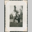 Young man and woman by fence (ddr-densho-321-241)