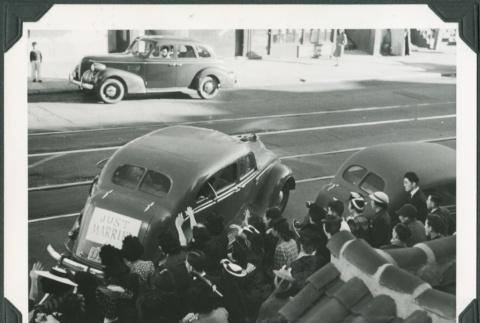 The bride and groom being seen off in a car (ddr-densho-300-236)