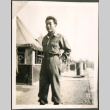 Soldier in front of tents (ddr-densho-201-494)