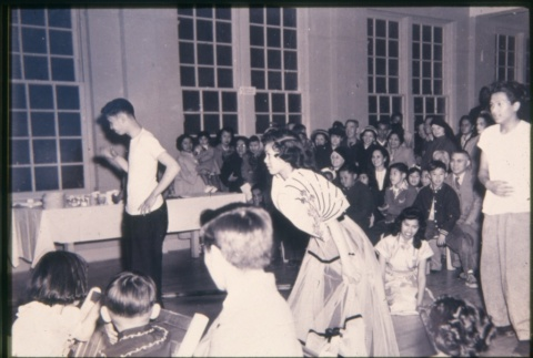 Group of young people in large room (in Maryknoll) (ddr-densho-330-124)