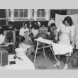 Teenage incarceree spending Sunday afternoon in various activities such as ironing, playing cards, etc. at Granada incarceration camp (ddr-csujad-14-37)