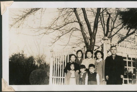 Group of adults and children near white fence (ddr-densho-321-210)