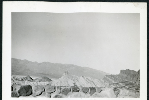 Photograph of Zabriske Point area in Death Valley with rock wall in the foreground (ddr-csujad-47-96)