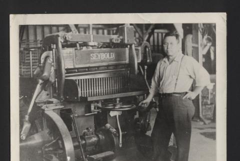 Photograph of man standing next to
