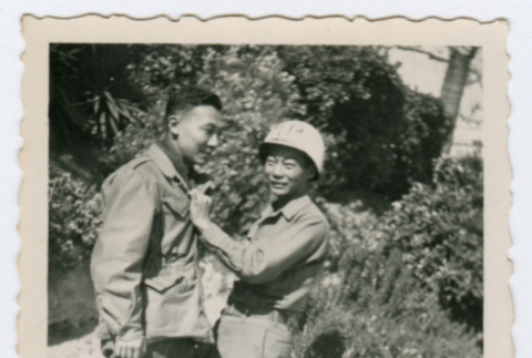 Two soldiers standing on garden path (ddr-densho-368-203)