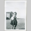 A toddler in front of MacDonald Hill cabins (ddr-densho-300-72)