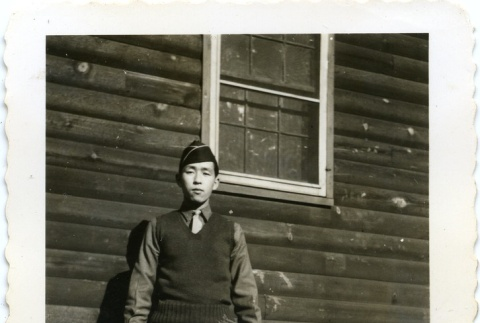 Soldier in front of a building (ddr-densho-22-168)