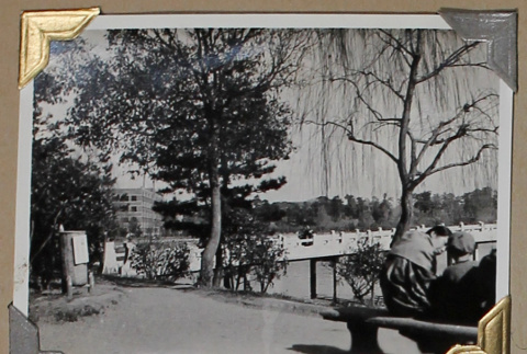 Two people sit on a bench (ddr-densho-404-279)