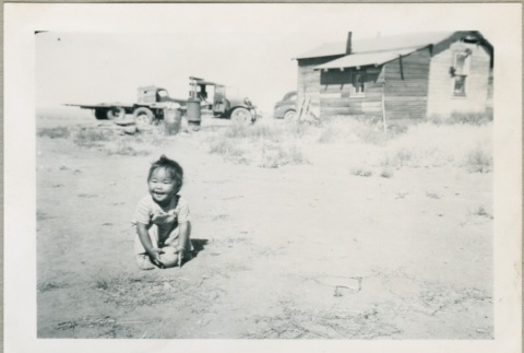 A toddler playing outside (ddr-densho-300-63)