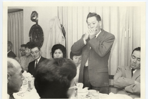 Performing with a harmonica (ddr-jamsj-1-546)