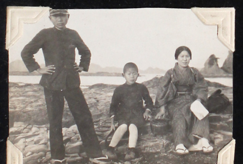 Woman and two boys on a rocky shore (ddr-densho-404-98)