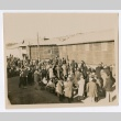 Crowd of people waiting with their luggage (ddr-densho-223-5)