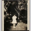 Girl standing in front of trees (ddr-densho-259-6)