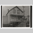 Two men stand on the steps of the Seattle Betsuin Buddhist Temple (ddr-sbbt-4-8)