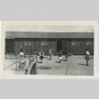 Children playing in front of barracks (ddr-manz-7-4)
