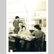 Soldiers writing letters (ddr-densho-22-233)