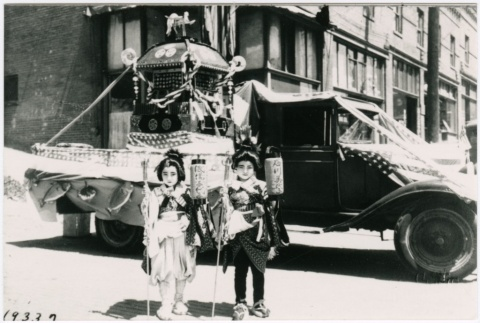 Two little girls posing in front of a parade float (ddr-densho-353-327)