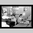 Dr. E.R. Kuwahara and Shizu Fukuyama in the Optical Department, Amache Co-op (ddr-csujad-55-1561)