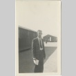 Man standing in front of barracks (ddr-manz-7-21)