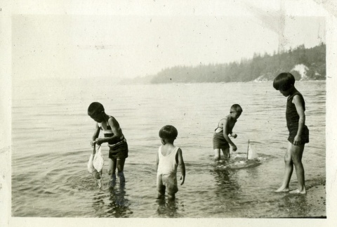 Children playing in water with sailboats (ddr-densho-182-53)