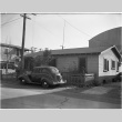 House with car parked in front (ddr-csujad-43-21)