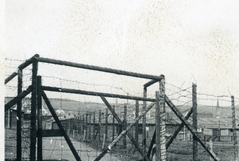 Barbed wire fence at Dachau concentration camp (ddr-densho-22-110)