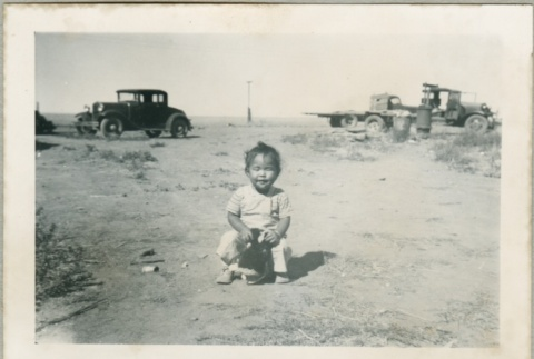 A toddler playing outside (ddr-densho-300-64)