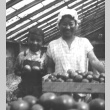 Woman and child with produce (ddr-densho-138-5)