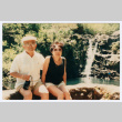 Bill and Tomi Iino sitting in front of waterfall (ddr-densho-368-291)