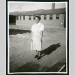 Photograph of a hospital nurse in front of a building (ddr-csujad-47-332)