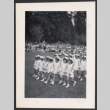 Lotus Kidettes Drill Team marches in a field (ddr-sbbt-6-102)