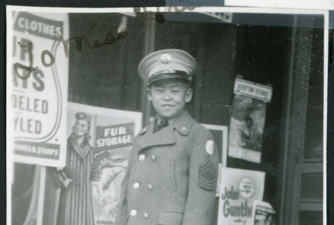 Photograph of Ned Morioka posing in front of a store front (ddr-csujad-47-139)