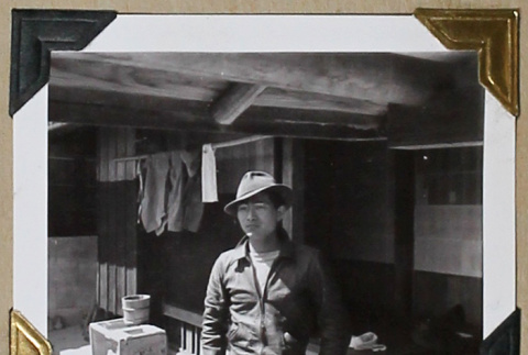 Tokeo Tagami in a jacket and fedora (ddr-densho-404-294)