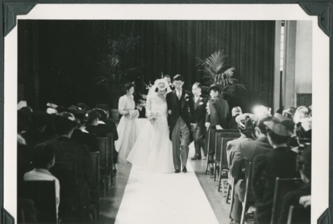 Newly married couple walking down the aisle (ddr-densho-300-233)
