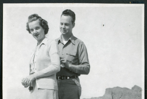 Photograph of Cleo and Pete Merritt standing on a short wall at Zabriskie Point in Death Valley (ddr-csujad-47-144)