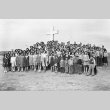 Group gathered in front of an outdoor cross in camp (ddr-fom-1-99)