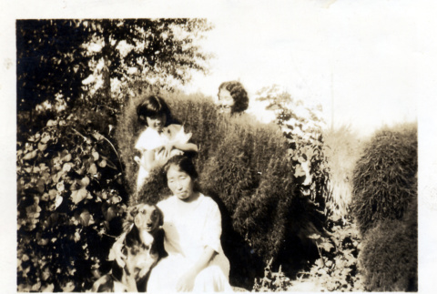 Mother and daughters in garden (ddr-densho-153-6)