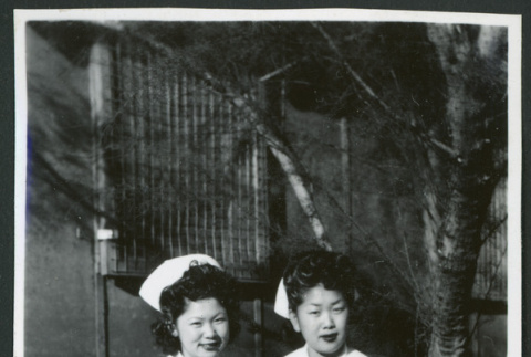 Photograph of nurses posing in front of the Manzanar hospital (ddr-csujad-47-200)