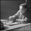 Japanese American playing a board game (ddr-densho-37-428)