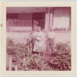 Man and woman standing in garden in front of house (ddr-densho-332-23)