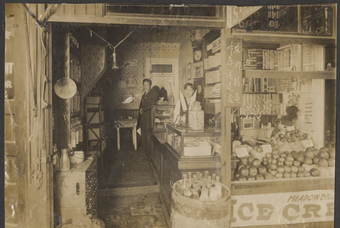 Two men stand inside a store (ddr-sbbt-1-8)