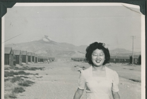 Woman walking with mail (ddr-densho-321-123)