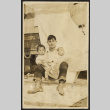 Man holds two babies in his arms (ddr-sbbt-1-11)