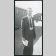 Photograph of Clyde Simpson standing in front of barracks (ddr-csujad-47-169)