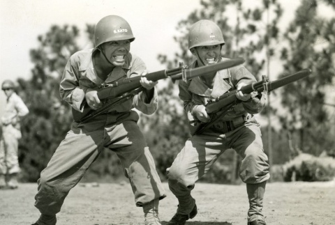Two soldiers practicing with bayonets at basic training (ddr-densho-22-489)