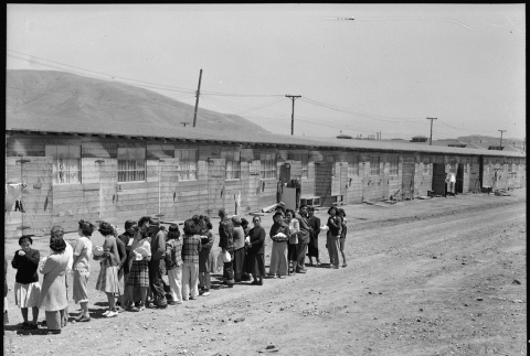 Japanese Americans in mess hall line (ddr-densho-151-44)