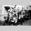 Soldiers sitting on a truck (ddr-densho-5-1)